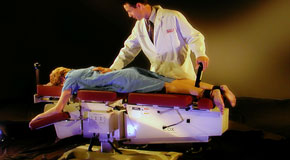 This is a picture of Cox Technic chiropratic spinal manipulation as performed at Cross Chiropractic Center.